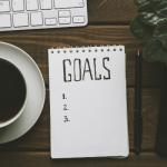 Set goals written on a notepad